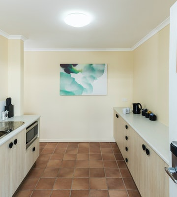 Kitchen in Three Bedroom Apartment at Nightcap at Balaclava Hotel