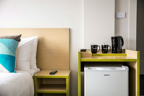 Caringbah Accommodation bedroom and sidetable Caringbah Hotel Nightcap