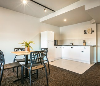 Kitchenette and Dining Area in One Bedroom Apartment at Nightcap at the Cheeky Squire