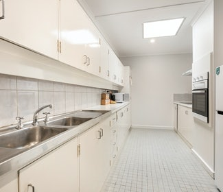 Kitchen in Two Bedroom Apartment at Nightcap at Coolaroo Hotel