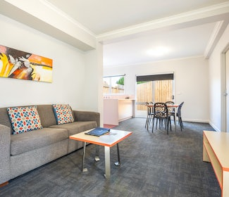 Living and Dining Area in Two Bedroom Apartment at Nightcap at Ferntree Gully Hotel Motel
