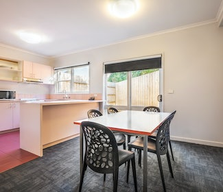 Dining Area in Two Bedroom Apartment at Nightcap at Ferntree Gully Hotel Motel