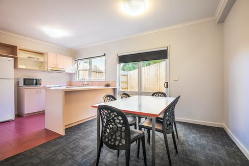 Kitchen and Dining Area in Two Bedroom Apartment at Nightcap at Ferntree Gully Hotel Motel