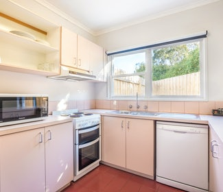 Kitchen in Two Bedroom Apartment at Nightcap at Ferntree Gully Hotel Motel