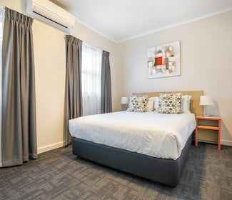 Bedroom in Two Bedroom Apartment at Nightcap at Ferntree Gully Hotel Motelq