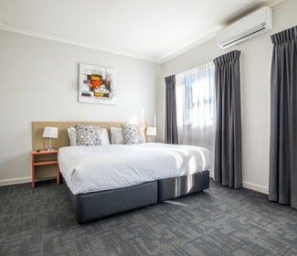 Bedroom in Two Bedroom Apartment at Nightcap at Ferntree Gully Hotel Motel