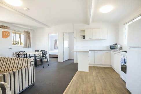 Kitchen and Dining Area in Two Bedroom Apartment at Nightcap at Golden Beach Tavern