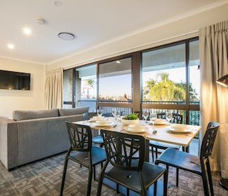 Dining Area in Three Bedroom Apartment at Nightcap at Kawana Waters Hotel