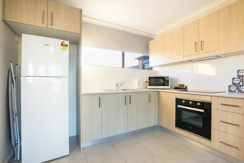 Kitchen in Three Bedroom Apartment at Nightcap at Kawana Waters Hotel