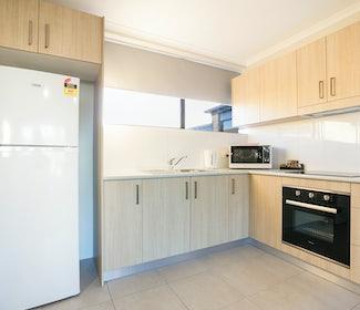 Kitchen in Three Bedroom Apartment at Nightcap at Kawana Waters Hotel
