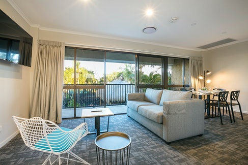 Living and Dining Area in Three Bedroom Apartment at Nightcap at Kawana Waters Hotel