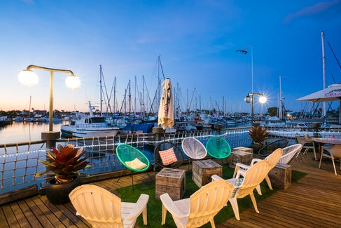 Outdoor Seating on the Marina at Nightcap at Kawana Waters Hotel