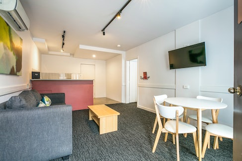 Living and Dining Area in One Bedroom Apartment at Nightcap at Matthew Flinders Hotel