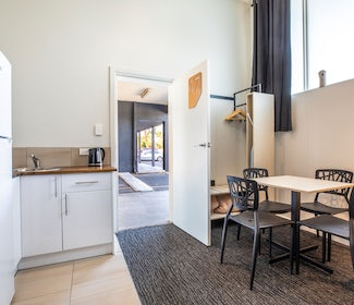 Kitchenette and Dining Area in One Bedroom Apartment at Nightcap at Seaford Hotel