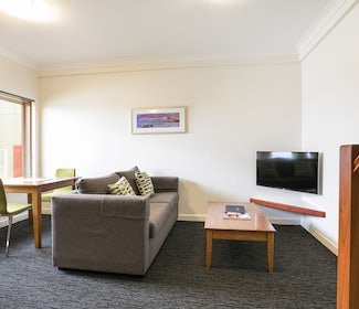 Living and Dining Area in One Bedroom Apartment at Nightcap at the Ship Inn