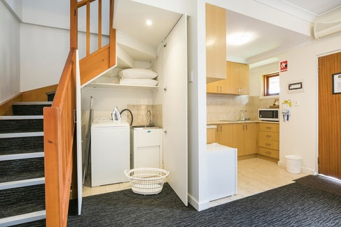 Laundry and Kitchen in One Bedroom Apartment at Nightcap at the Ship Inn