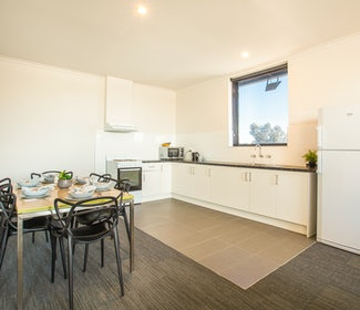 Kitchen and Dining Area in Two Bedroom Apartment at Nightcap at St Albans Hotel