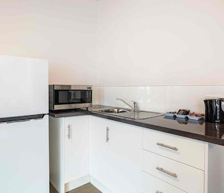 Kitchenette in Four Bedroom Apartment at Nightcap at Waltzing Matilda Hotel