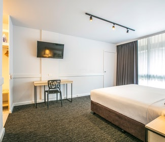 Bedroom in One Bedroom Apartment at Nightcap at Matthew Flinders Hotel