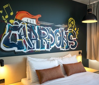Annerley studio queen feature bedroom at nightcap at Chardons Corner Hotel