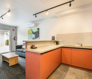 Kitchen in One Bedroom Apartment at Nightcap at Matthew Flinders Hotel