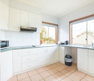 Kitchen in Three Bedroom Apartment at Nightcap at Federal Hotel