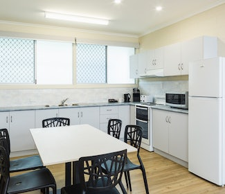 Kitchen and Dining Area in Three Bedroom Apartment at Nightcap at Edge Hill Tavern