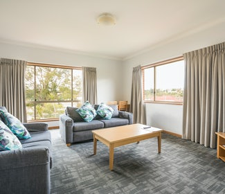 Living Area in Three Bedroom Apartment at Nightcap at Federal Hotel