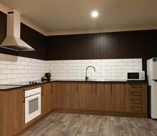 Kitchen in Three Bedroom Apartment at Nightcap at Archer Hotel