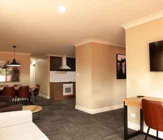 Kitchen/Living/Dining Area in Three Bedroom Apartment at Nightcap at Archer Hotel