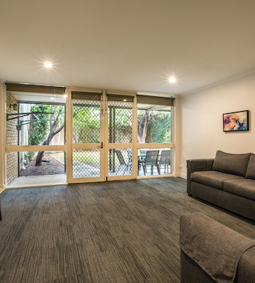 Living Area in Two Bedroom Apartment at Nightcap at Coolaroo Hotel