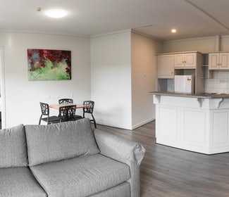 Kitchen, Living and Dining Area in One Bedroom Apartment at Nightcap at Rose and Crown Hotel