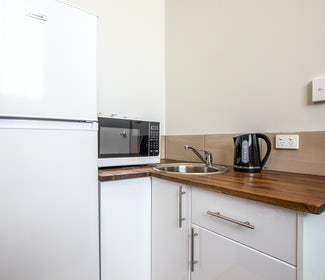 Kitchenette in One Bedroom Apartment at Nightcap at Seaford Hotel