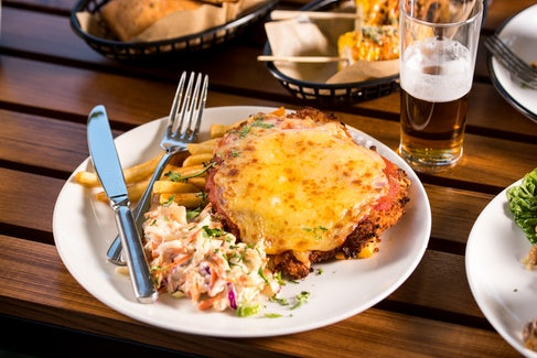 Chicken Parma and Beer at Nightcap at Golden Beach Tavern