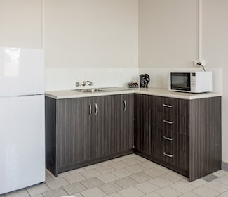 Kitchenette in Two Bedroom Apartment at Nightcap at Emerald Star Hotel